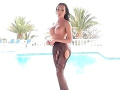 Mia Stroking Her Huge Throbbing Dong by the Poolside