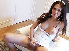 Horny tgirl Nikki playing with her juicy dick