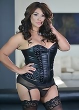 Vaniity in sexy black corset gets horny and plays with her cock and balls